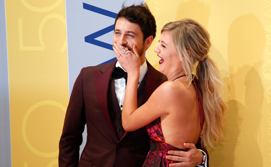 "Singer Kelsea Ballerini poses with a guest. Breakout Tennessee singer-songwriter Kelsea Ballerini brought the first solo performance to the CMA Awards on Wednesday with her recent number ""Peter Pan."" (Photos: Reuters)"