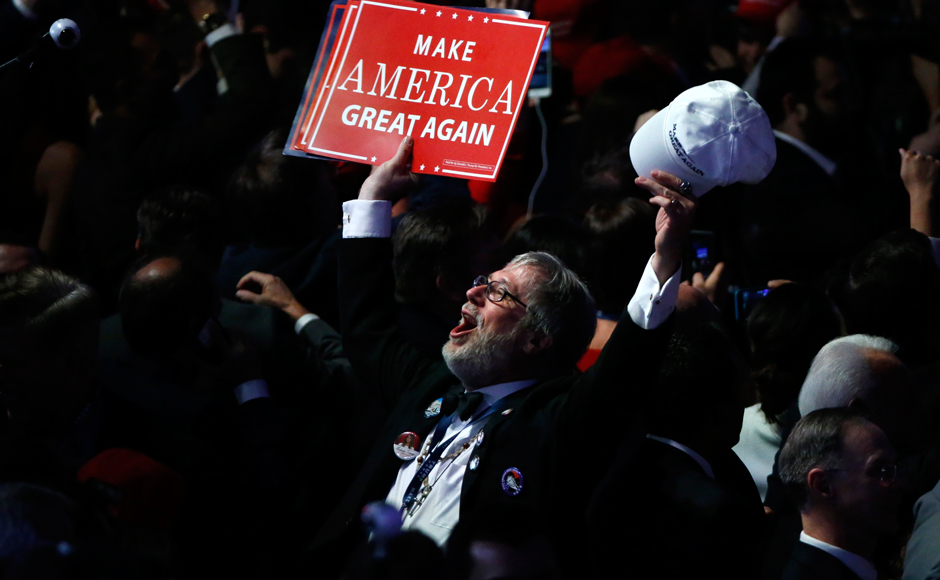 A Trump supporter celebrates as election returns come in at Republican U.S. presidential nominee Donald Trump's election night rally in Manhattan, New York, U.S., November 8, 2016. REUTERS/Jonathan Ernst TPX IMAGES OF THE DAY
