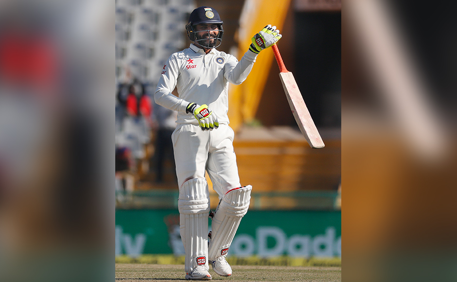 India's Ravindra Jadeja waves his bat after scoring a half century on the third day of their third cricket test match against England in Mohali, India, Monday, Nov. 28, 2016. (AP Photo/Altaf Qadri)