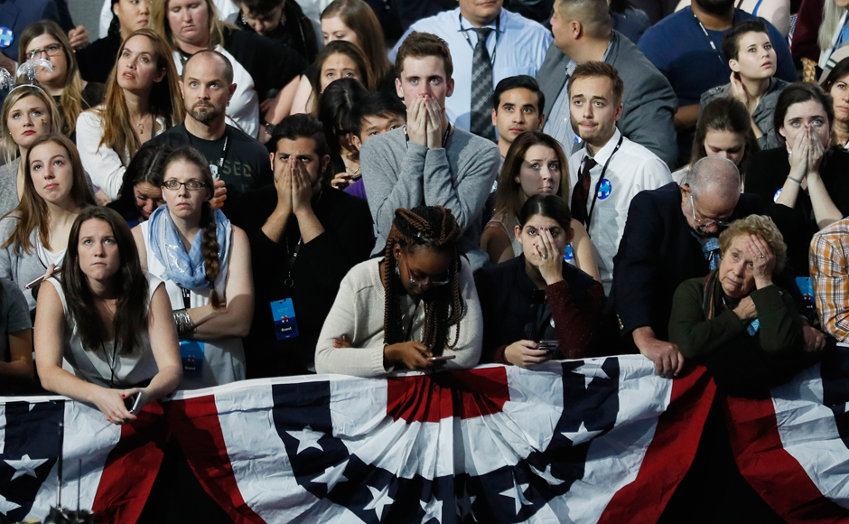 Supporters of Democratic U.S. presidential nominee Hillary Clinton react as they watch election returns showing Donald Trump winning in Florida at the election night rally in New York, U.S., November 8, 2016. REUTERS/Rick Wilking
