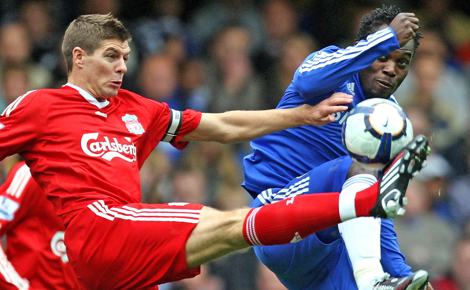 """In this Sunday Oct. 4, 2009 file photo, Liverpool's Steven Gerrard, left, and Chelsea's Michael Essien challenge for the ball during their English Premier League soccer match at Stamford Bridge stadium, London. Gerrard, the former Liverpool and England captain, announced his retirement from professional soccer on Thursday, Nov. 24, 2016 and said he is considering a """"number of options"""" about his next career move. (AP Photo/Tom Hevezi, File)"""