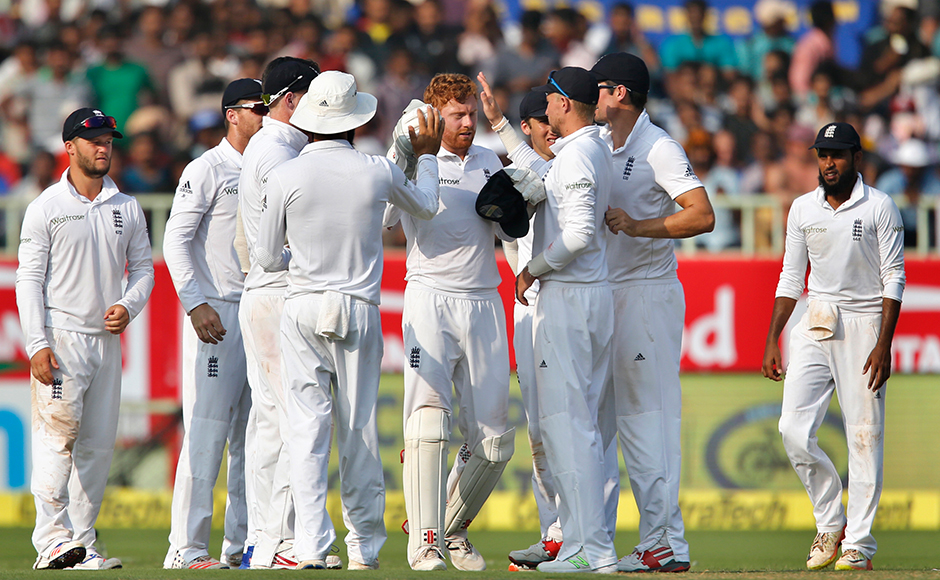 England's Jonny Bairstow, center, celebrates with teammates the dismissal of India's Cheteshwar Pujara on the first day of their second cricket test match in Visakhapatnam, India, Thursday, Nov. 17, 2016. (AP Photo/Aijaz Rahi)