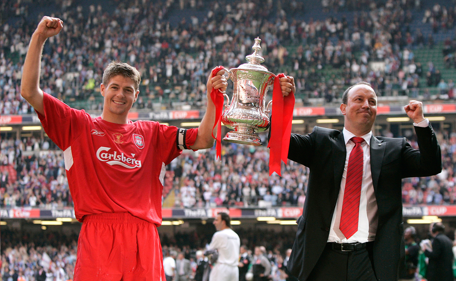 """In this Saturday, May 13, 2006 file photo, Liverpool's Steven Gerrard, left, and manager Rafael Benitez celebrate with the trophy after Liverpool's victory against West Ham United in the FA Cup Final soccer match at the Millennium Stadium in Cardiff, Wales. Gerrard, the former Liverpool and England captain, announced his retirement from professional soccer on Thursday, Nov. 24, 2016 and said he is considering a """"number of options"""" about his next career move. (AP Photo/Matt Dunham, File)"""