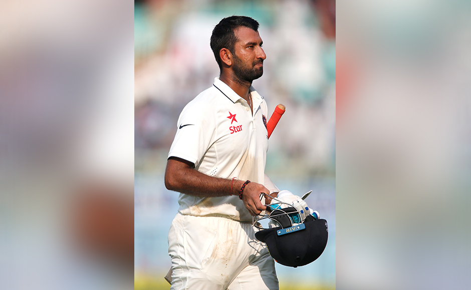 India's Cheteshwar Pujara leaves the ground after losing his wicket on the first day of their second cricket test match against England in Visakhapatnam, India, Thursday, Nov. 17, 2016. (AP Photo/Aijaz Rahi)