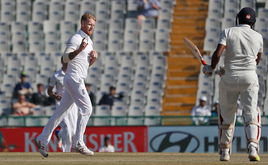 England's Ben Stokes, left, celebrates after taking the wicket of India's Ravichandran Ashwin, right, on the third day of their third cricket test match in Mohali, India, Monday, Nov. 28, 2016. (AP Photo/Altaf Qadri)