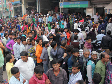 People outside a bank in Gurugram. File photo. PTI