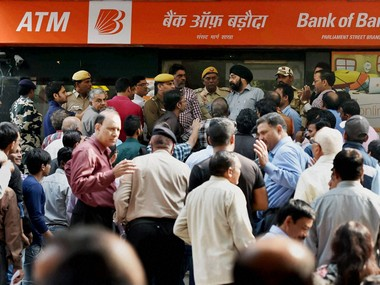 New Delhi: People scuffle to exchange Rs 500 and Rs 1000 notes at a bank in New Delhi on Friday. PTI Photo by Vijay Verma (PTI11_11_2016_000235B)