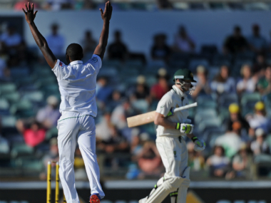 South Africa's Kagiso Rabada (L) celebrates taking Steve Smith's wicket. AFP