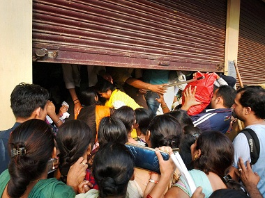 People crowd outside a bank at Paharganj in New Delhi. PTI