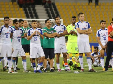 A disappointed Bengaluru FC players watch on after 1-0 loss in the final. AFP