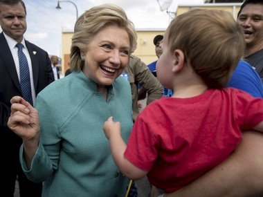 Democratic presidential candidate Hillary Clinton greets a baby outside an early voting center in West Miami. AP