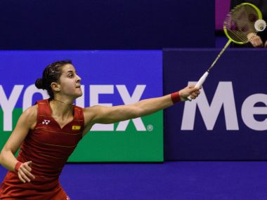 Spain's Carolina Marin hits a shot against Taiwan's Tai Tzu-ying during their semi-final women's singles match at the Hong Kong Open badminton tournament in Hong Kong on November 26, 2016. / AFP PHOTO / Anthony WALLACE