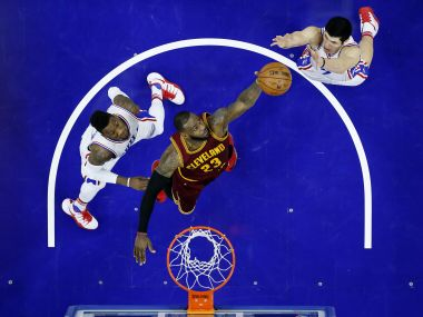 Cleveland Cavaliers' LeBron James leaps for a rebound against Philadelphia 76ers' Ersan Ilyasova and Robert Covington. AP