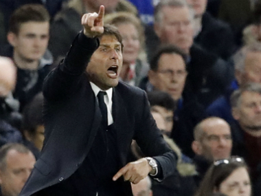 Chelsea boss Antonio Conte gives instructions to his players during the match against Tottenham. AP