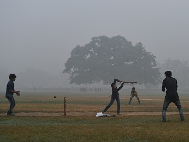 Smog or no smog, nothing stops maidan cricket. AFP