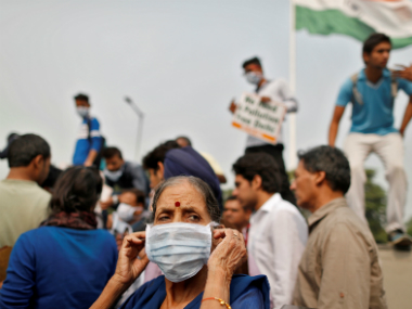People in masks protesting over the pollution in Delhi. Reuters