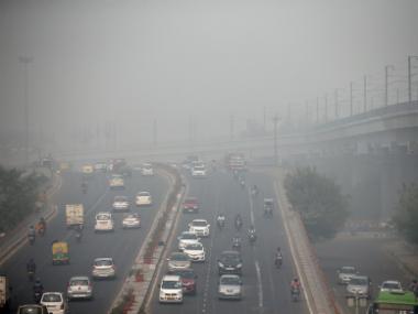 Traffic driving through smog in Delhi. Reuters