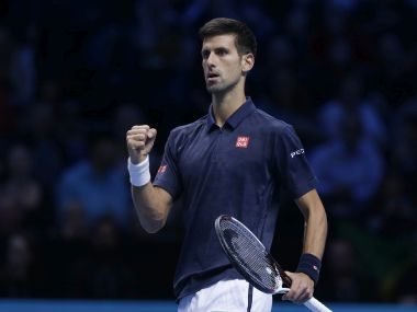 Novak Djokovic celebrates after winning a point against Milos Raonic. AP