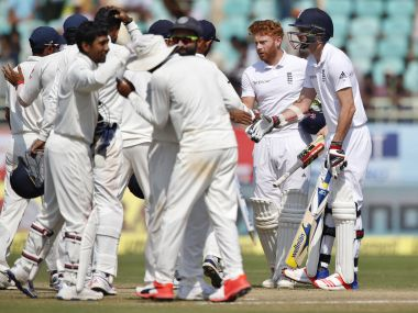 England's James Anderson and Jonny Bairstow shake hands with Indian players after their loss. AP