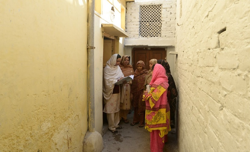 """Sehat Saheli Meherunissa, doing a door to door visit. """"Women around this area didn't know anything about their health. They could not even talk about their menstruation cycle. Initially they didn't even want to talk to us, men used to say these AKTC people are bad, don't let them talk to our women. But today they depend upon us, trust us. It feels great to be part of this change,"""" Said Meherunissa. Photo AKTC"""
