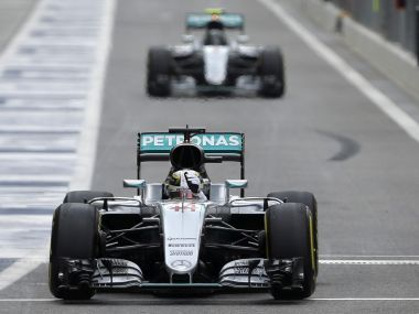Lewis Hamilton followed by teammate Nico Rosberg leaves the pit lane during the first free practice. AP