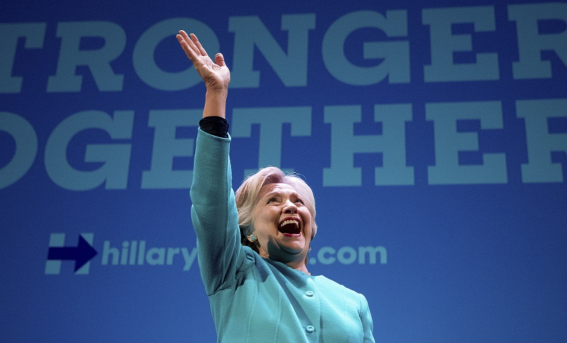 Democratic presidential candidate Hillary Clinton waves as she takes the stage to speak at a fundraiser at the Paramount Theatre in Seattle, Friday, Oct. 14, 2016. (AP Photo/Andrew Harnik)