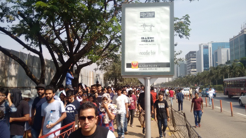Attendees queue up outside the concert venue