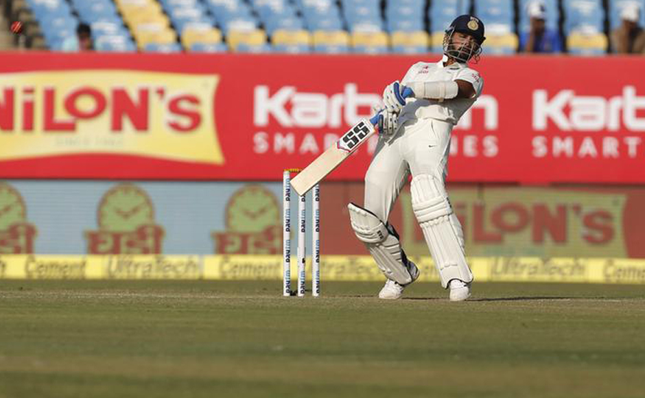 Indian opener Murali Vijay evades a rising delivery against England on Day 2 of the 1st Test at Rajkot. Reuters