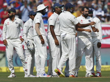 India celebrate the wicket of Alastair Cook. AP