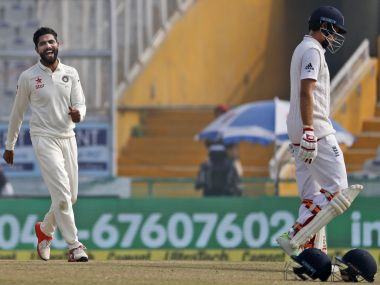 Joe Root walks back to the pavilion as Ravindra Jadeja celebrates. AP