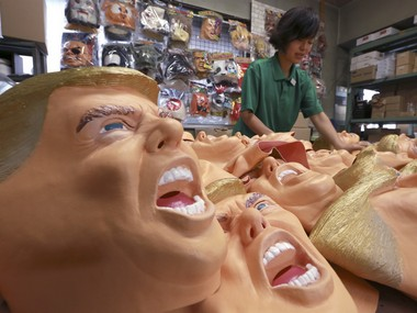 A worker prepares the final touches on rubber masks depicting President-elect Donald Trump at the Ogawa Studio in Saitama, north of Tokyo. AP