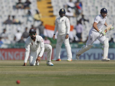 India skipper Virat Kohli watches the ball run away to the fence off Jonny Bairstow's bat. AP