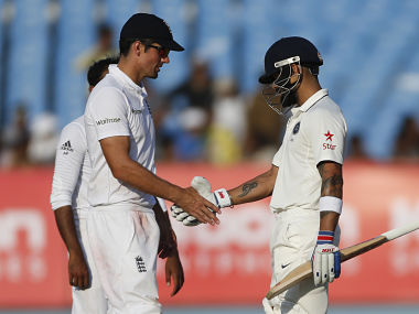 Indian cricket captain Virat Kohli shakes hand with England's cricket captain Alastair Cook at the end of the fifth day of their first Test match. AP