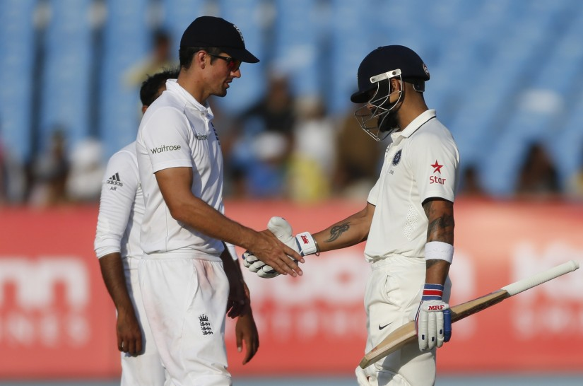Indian Test captain Virat Kohl with England's captain Alastair Cook. AP