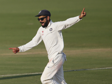 Kohli celebrates a wicket against England. AP