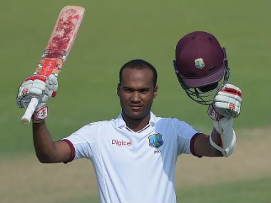 Kraigg Brathwaite celebrates after reaching his century on Day 3 of the final Test at Sharjah. AFP