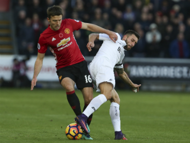 File image of Michael Carrick (L). AFP