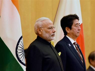 Tokyo: Prime Minister Narendra Modi with Japanese Prime Minister Shinzo Abe during his ceremonial welcome in Tokyo. PTI