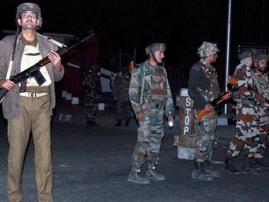 Security personnel after an encounter with millitants at Army camp in Nagrota area of Jammu on Tuesday. PTI