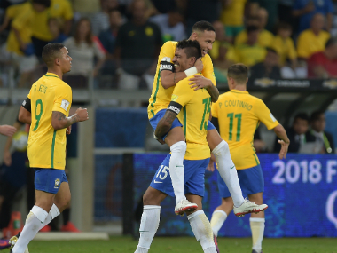 Neymar celebrates with his Brazil teammates. AFP