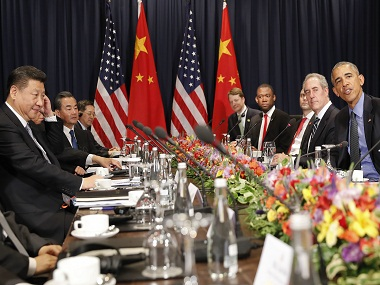 U.S. President Barack Obama, right, and China's President Xi Jingping, left, sit with members of their delegations for a meeting during the Asia-Pacific Economic Cooperation (APEC) in Lima, Peru, on Saturday, Nov. 19, 2016. (AP Photo/Pablo Martinez Monsivais)