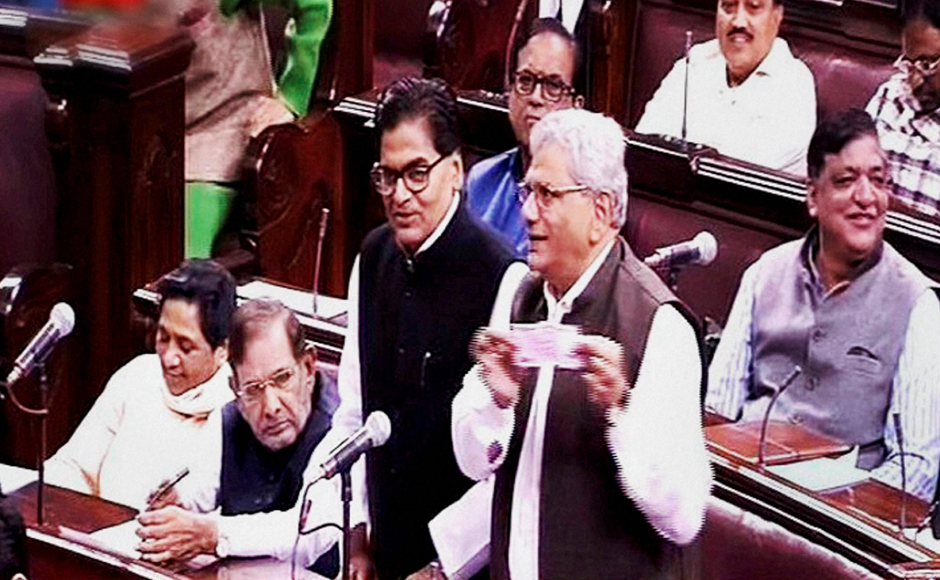 Samajwadi Party members Ramgopal Yadav speaks as CPI(M) leader Sitaram Yechury shows a Rs 2000 note in the Rajya Sabha on the opening of the winter session of Parliament in New Delhi on Wednesday. PTI Photo / TV GRAB (PTI11_16_2016_000066B)