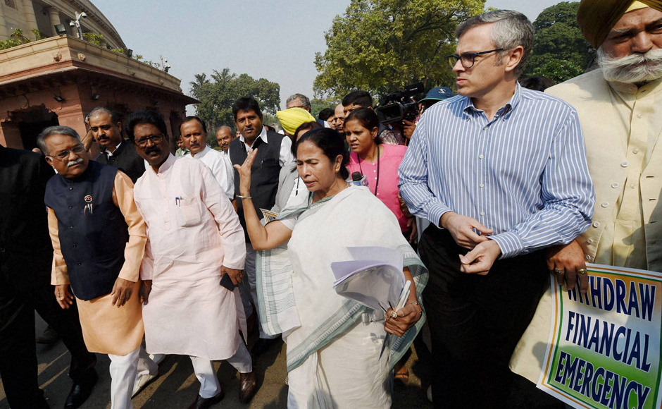 """""""Stop harassment of the common people by lifting of all sorts of restrictions recently thrust upon them,"""" the five-page memorandum said, and added """"ensure that supply of essential commodities in adequate quantities be restored in the markets forthwith."""" Before beginning the march from Parliament, Mamata said """"The march is to save common people from disaster."""" (Photo: PTI)"""