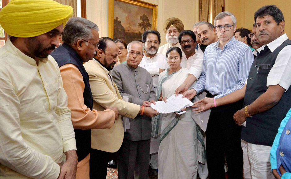 President Pranab Mukherjee receives a memorandum from West Bengal Chief Minister Mamata Bannerjee, AAP leader Bhagwant Mann, National Conference leader Omar Abdullah and a delegation of MPs over demonetisation issue, at Rashtrapati Bhavan in New Delhi on Wednesday. PTI Photo (PTI11_16_2016_000134B)