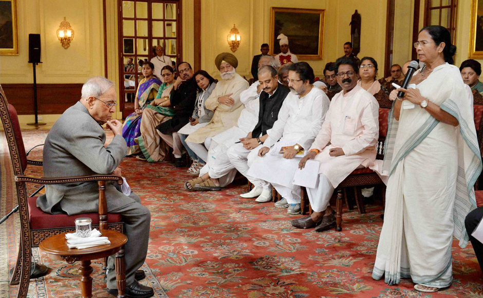 TMC Supremo and West Bengal Chief Minister Mamata Bannerjee speaks as a delegation of MPs led by her and National Conference leader Omar Abdullah meeting President Pranab Mukherjee over demonetisation issue, at Rashtrapati Bhavan in New Delhi on Wednesday. PTI Photo (PTI11_16_2016_000138B)