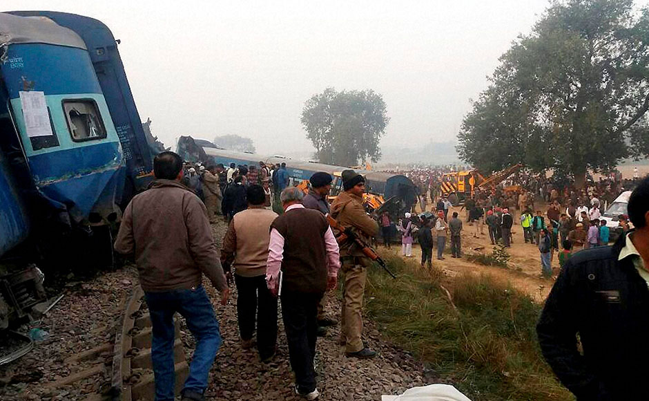 Kanpur: Police officers on the spot where 14 coaches of the Indore-Patna express derailed, killing around 90 people and injuring 150, in Kanpur Dehat on Sunday. PTI Photo(PTI11_20_2016_000006B)
