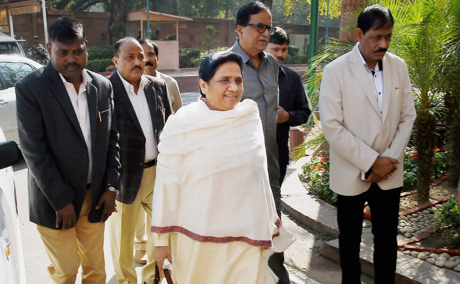 MP and BSP Supremo Mayavati accompanied by her party MP'S arrives in Parliament on Tuesday. PTI Photo by Shirish Shete(PTI11_22_2016_000084B)