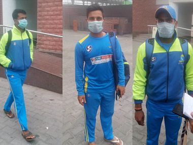 Combo pictures of Bengal Captain Manoj Tiwary and Wicket-keeper Shreevats GoswamiPragyan Ojha (wearing anti-air pollution mask. PTI