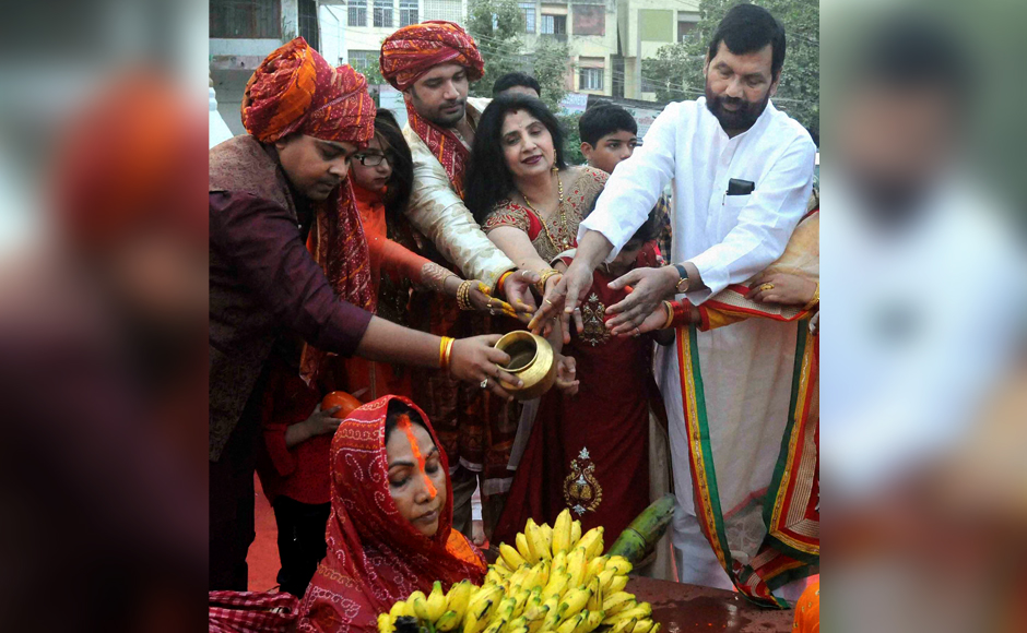Union Minister Ram Vilas Paswan, his wife and son and MP Chirag Paswan performing rituals on the occasion of the Chhath festival in Patna on Sunday. PTI Photo(PTI11_6_2016_000165B)
