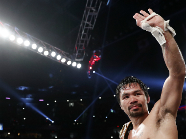 Manny Pacquiao celebrating his win against Jesse Vargas. AP